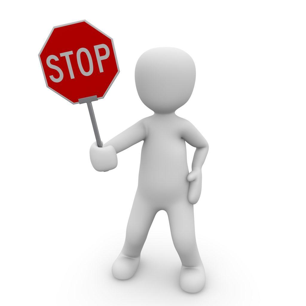 Cartoon holding stop sign