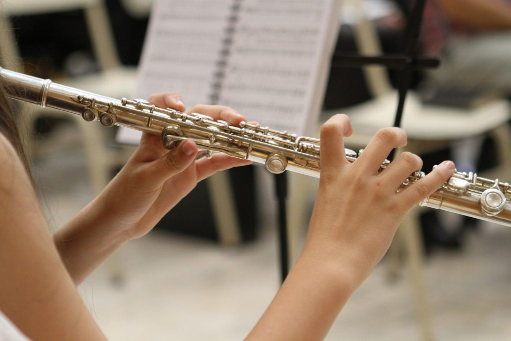 Hands playing a flute