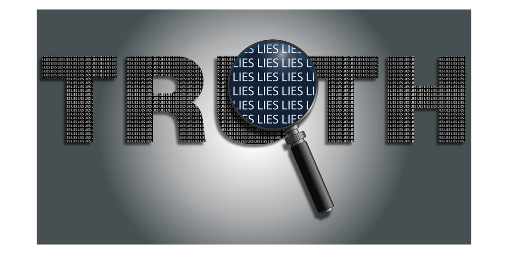 """The word """"truth"""" with a magnifying glass over it revealing the word """"lies"""" over and over."""